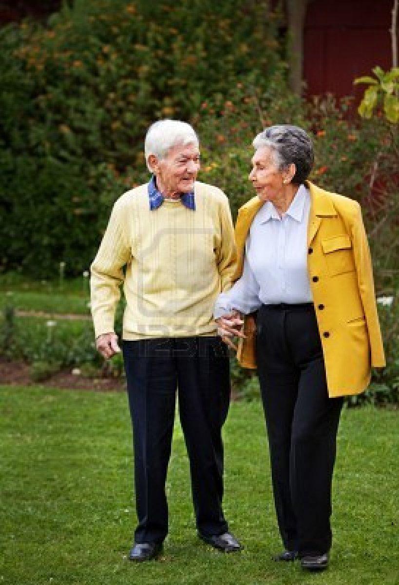 elder couple walking together at the park