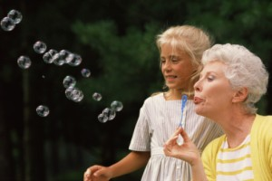 an elder blowing bubbles